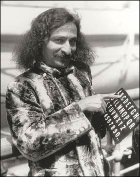 Meher Baba maintained silence and communicated using an alphabet board