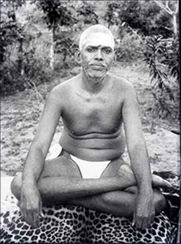 Ramana Maharashi, enlightened spiritual teacher, sitting on a tiger skin